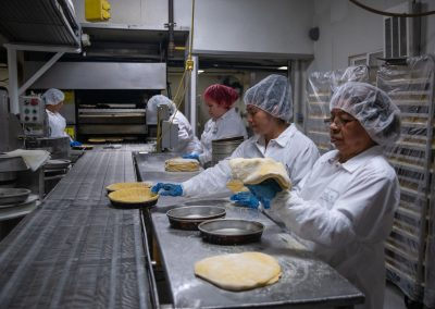 Deep Dish Pizza Crust Preparation on Manufacturing Line