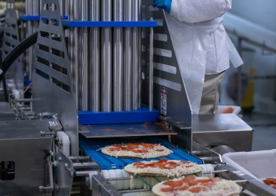 Pepperoni Machine and Conveyor System on Thin Crust Frozen Pizza Manufacturing Line